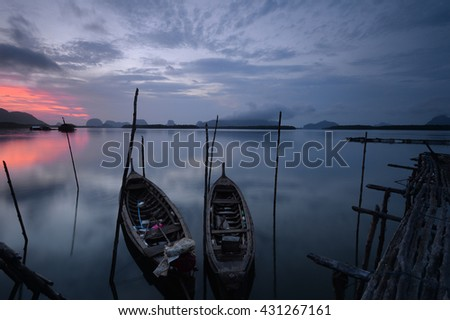 Boat fisher man at sunrise time.Thailand/ - stock photo