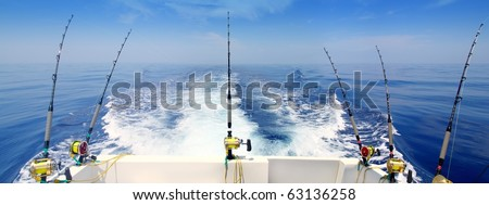 boat fishing trolling panoramic rod and reels blue sea wake [Photo Illustration] - stock photo