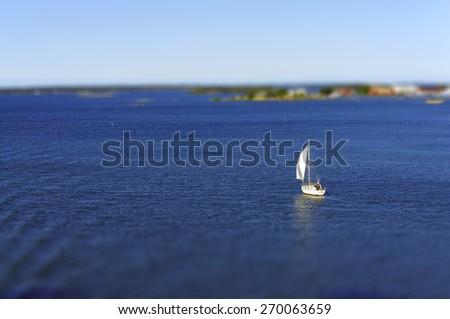 Boat floating at the Baltic Sea, Karlskrona, Sweden. Tilt-shift method - stock photo