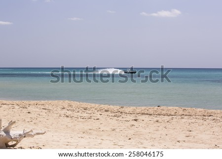 Boat floating on the waves of the sea - stock photo