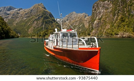 Boat from Sandfly Point - the last point Mildford Track - stock photo
