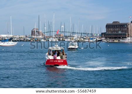 Boat heading into a New England harbor - stock photo