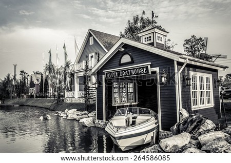 Boat house beside the river in old style photo