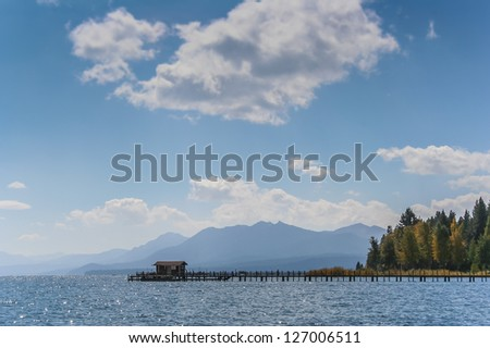 Boat house in lake Tahou in the fall - stock photo