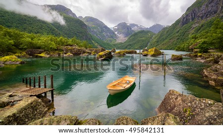 Boat in a lake close to  Buerbreen Glacier, Norway
