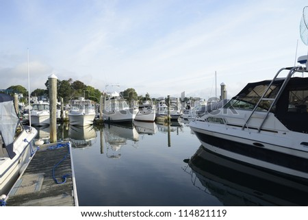 boat in a  marina in Niantic Connecticut in the morning - stock photo
