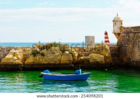 Boat in a Quiet Harbor on the Atlantic Coast of Portugal - stock photo