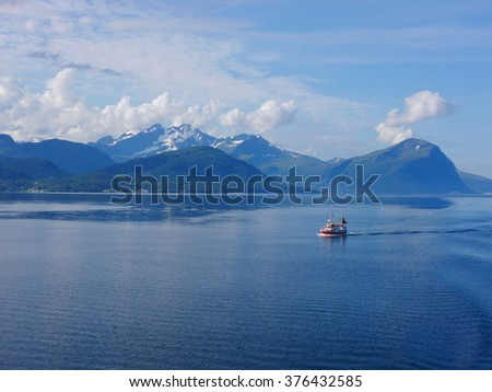 Boat in beautiful fjord  - stock photo