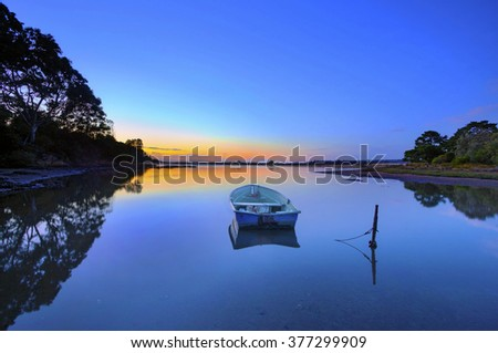Boat in bega during dawn