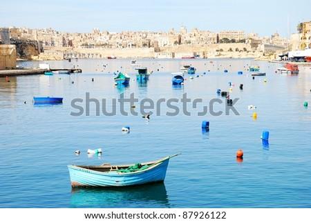 Boat in calm bay - stock photo