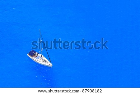 boat in deep blue water view from above - stock photo