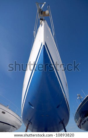 boat in dry dock, waiting for sailing season, shot with wide angle lenses - stock photo