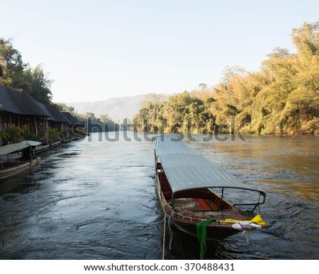 Boat in river Kwai with mountain background, Kanchanaburi province, Thailand