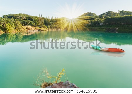 Boat in river with over light the sun and sky background