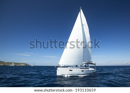 Boat in sailing regatta. Luxury yachts. - stock photo