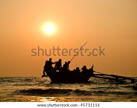 Boat in sunset - stock photo