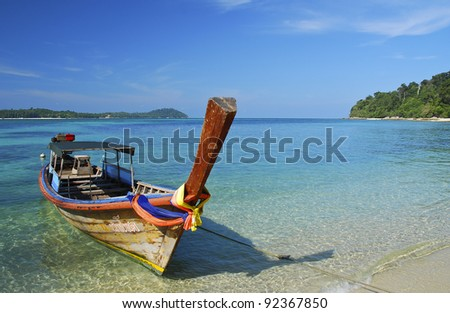 Boat in the clear sea and blue sky