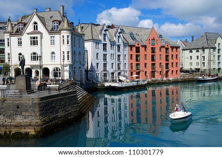 Boat in the harbour of Alesund Norway - stock photo