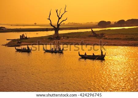 Boat in The Lake During Sunset at Mandalay , Myanmar - stock photo