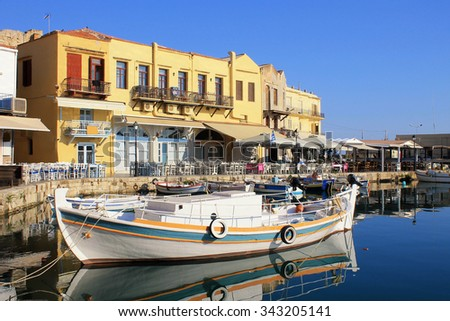 Boat in the old venetian port, Rethymno, Crete island,Greece. - stock photo