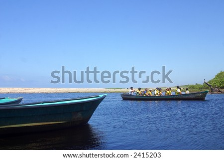 boat in the river for the tour to a cocodrile farm and to go cocodrile watching in tne proximity of San Agustinillo in the southern State of Oaxaca in Mexico, Latin America - stock photo