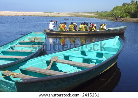 boat in the river for the tour to a crocodile farm and to go cocodrile watching in tne proximity of San Agustinillo in the southern State of Oaxaca in Mexico, Latin America - stock photo