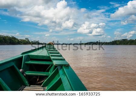 boat in the river in the peruvian Amazon jungle at Madre de Dios Peru - stock photo