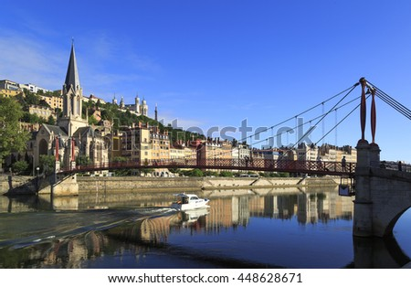 Boat in the Saone rivier in front of the Church of Saint Georges, Lyon, France.