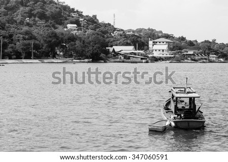 boat in the sea black and withe - stock photo
