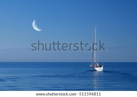 boat in the sea with moon in the sky