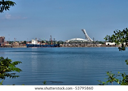 Boat in the South Facade Harbour and Stadium Background of Montreal - stock photo