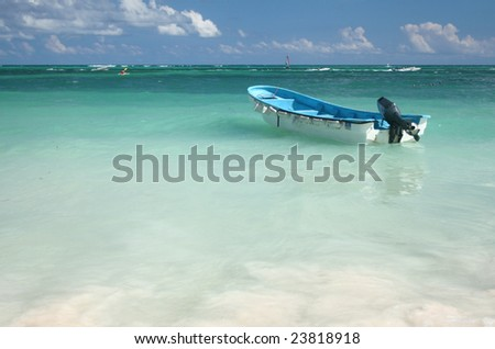 Boat in Tropical, Caribbean Ocean Waters, versatile for a variety of designs - stock photo