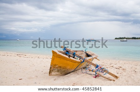 boat in tropical sea on island - stock photo