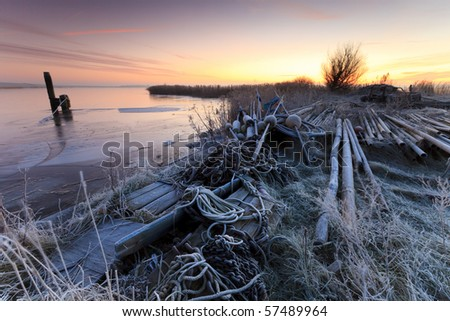 Boat in winter and a beautiful sunrise
