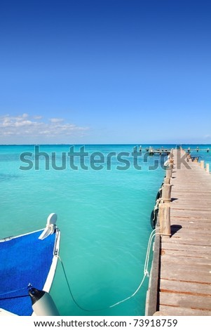 boat in wooden pier Cancun tropical Caribbean sea