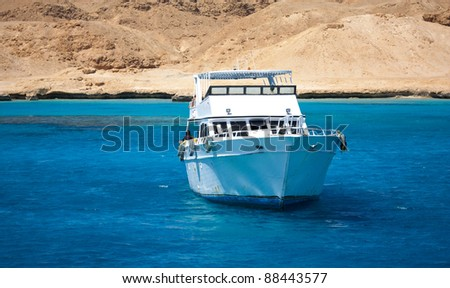 Boat is floating in a beautiful water - stock photo