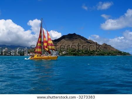 Boat is sailing in beautiful Hawaii - stock photo