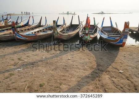 Boat made of wood, U-Bein Bridge, Amarapura, Myanmar - stock photo