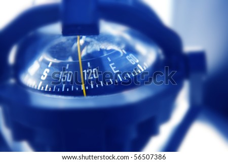 boat marine compass in black blue light backlight boat control - stock photo