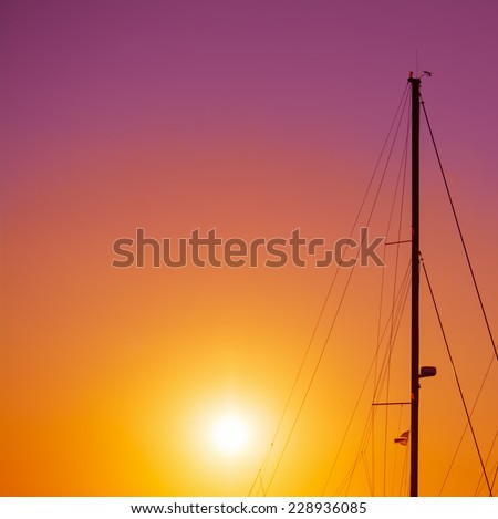 boat mast silhouette under a colorful sunset. Shot in Alghero, Italy - stock photo