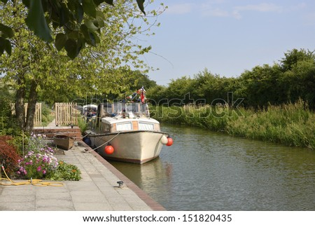 Boat moored at Honeystreet Wharf on the Kennet and Avon Canal near Devizes. Wiltshire. England - stock photo