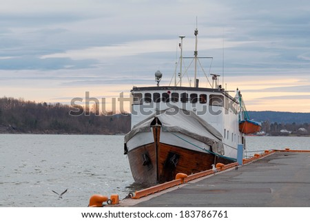 Boat moored at Oslo harbour - stock photo