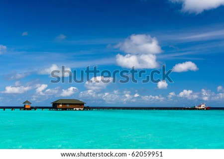 Boat moored at tropical island - stock photo