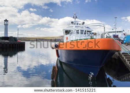Boat moored in Kirkwall Harbour - stock photo