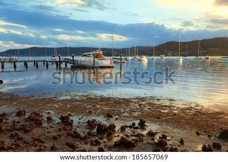 Boat moorings in the late afternoon sun, at Point Frederick, Gosford NSW Australia - stock photo