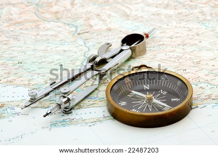 boat navigation - compass and marine map studio isolated - stock photo