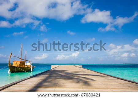 boat near a pier - stock photo