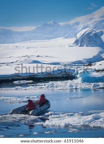 boat near the snowy glaciers in Antarctica - stock photo