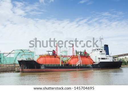 boat of oil tanker at port  - stock photo