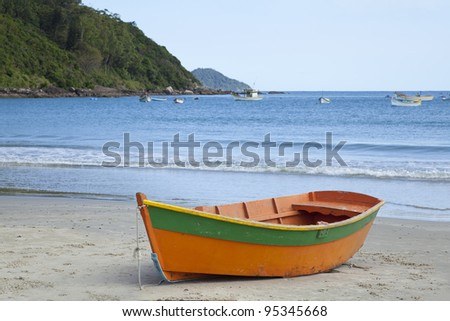 Boat on a Beach in Florianopolis, Brazil - stock photo